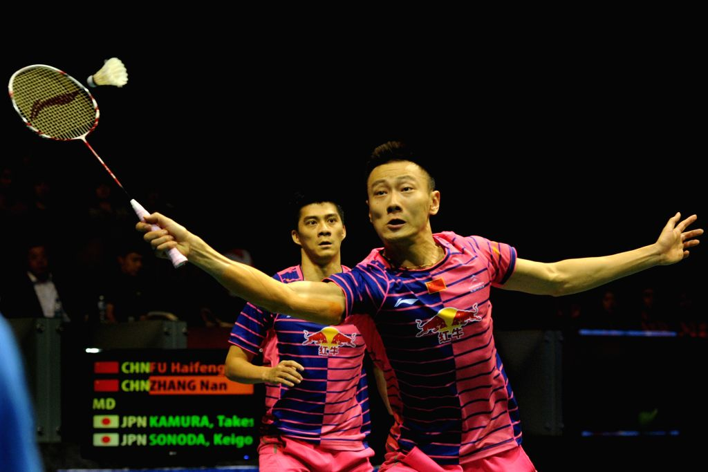 SINGAPORE, April 17, 2016 - Fu Haifeng/Zhang Nan (front) of China compete against Takeshi Kamura/Keigo Sonoda of Japan during the men's doubles final match at the OUE Singapore Open in Singapore ...