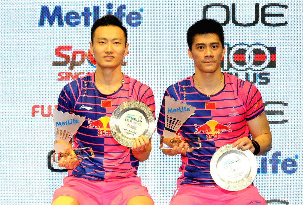 SINGAPORE, April 17, 2016 - Fu Haifeng/Zhang Nan (L) of China attend the victory ceremony after winning their men's doubles final match against Takeshi Kamura/Keigo Sonoda of Japan at the OUE ...