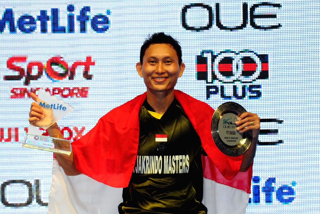 SINGAPORE, April 17, 2016 - Sony Dwi Kuncoro of Indonesia attends the awarding ceremony after winning his men's singles final match against Son Wan Ho of South Korea at the OUE Singapore Open in ...