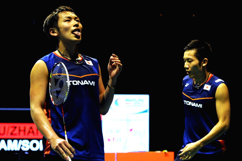 SINGAPORE, April 17, 2016 - Takeshi Kamura/Keigo Sonoda (R) of Japan react during the men's doubles final match against Fu Haifeng/Zhang Nan of China at the OUE Singapore Open in Singapore Indoor ...