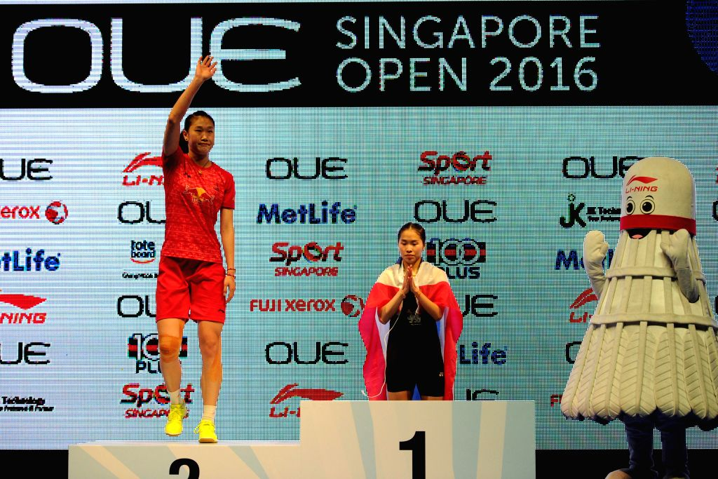 SINGAPORE, April 17, 2016 - Thailand's player Ratchanok Intanon (C) and China's player Sun Yu (L) attend the awarding ceremony after the OUE Singapore Open women's singles final match held at ...