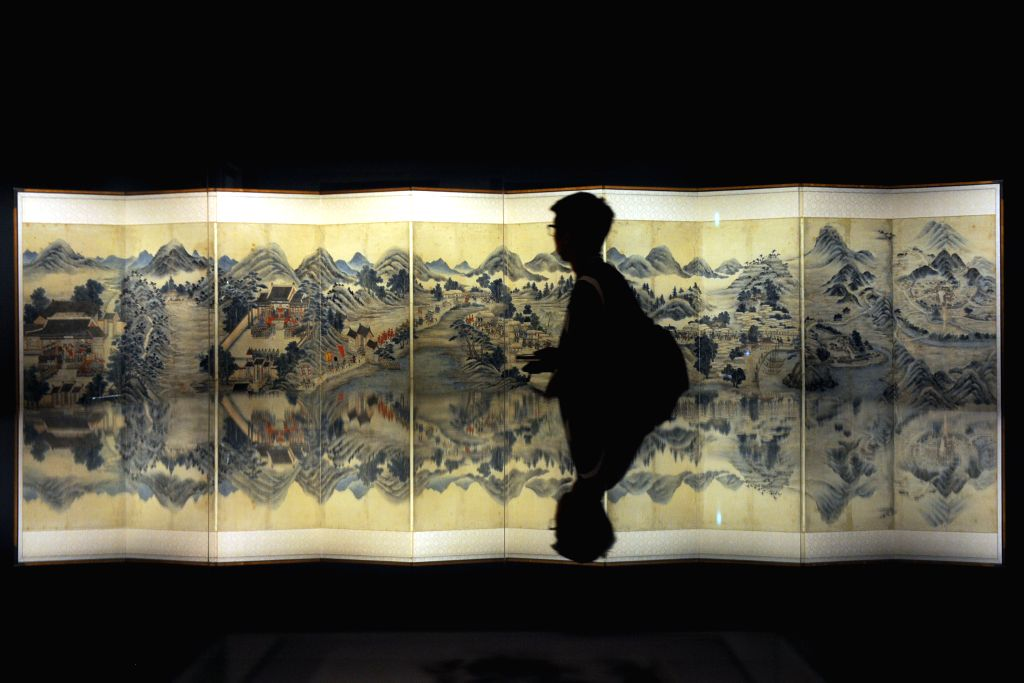 """SINGAPORE, April 20, 2017 - A member of the media previews an exhibition entitled """"Joseon Korea: Court Treasures and City Life"""" at Singapore's Asian Civilisations Museum, on April 20, 2017. ..."""