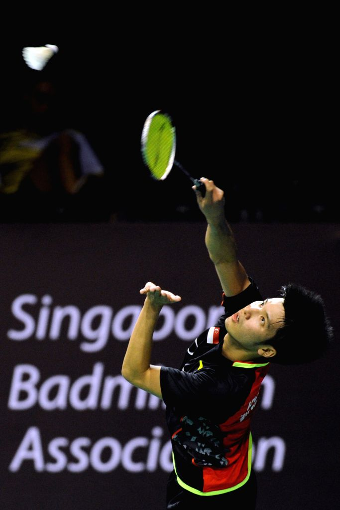Singapore's badminton player Derek Wong returns a ball during the second round qualifying match of the OUE Singapore Open against Malaysia's badminton player ...