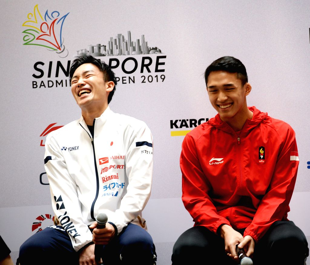 SINGAPORE, April 9, 2019 - Kento Momota (L) of Japan and Jonatan Christie of Indonesia attend the pre-match press conference of the Singapore Badminton Open held in Singapore on April 9, 2019.
