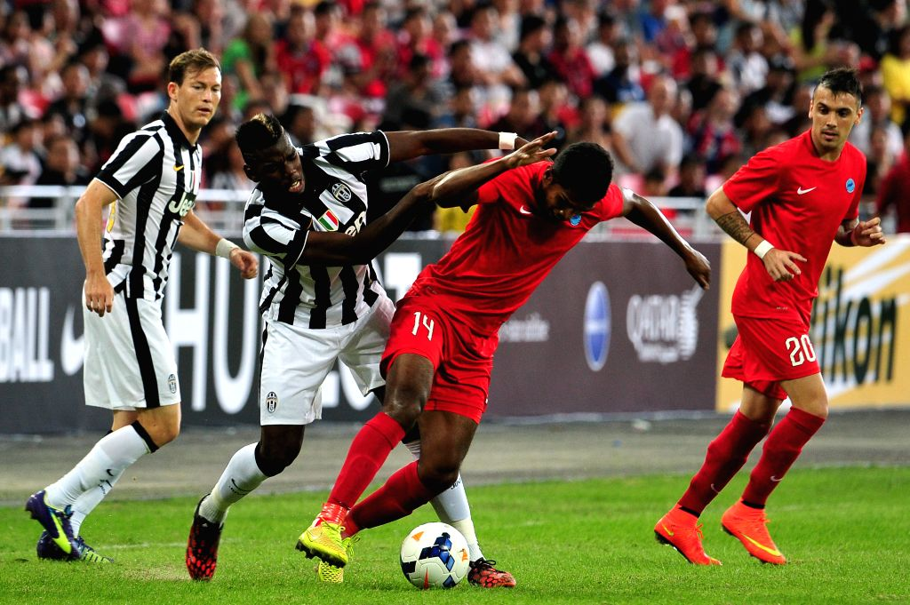 Juventus' Paul Pogba (2nd L) vies for the ball in the friendly match between Singapore selection team and Juventus in the Singapore National Stadium on Aug 16, ...