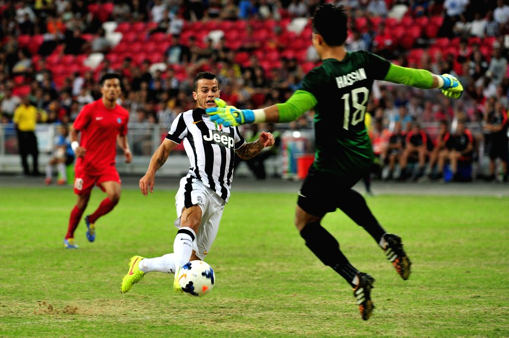 Juventus' Sebastian Giovinco (C) shoots in the friendly match between Singapore selection team and Juventus in the Singapore National Stadium on Aug 16, 2014. ...