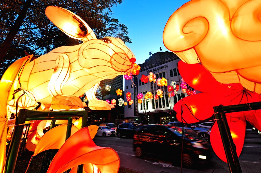 Floral lanterns light up the street for the Mid-Autumn Festival media preview in Singapore's Chinatown, Aug 19, 2014.  ****Authorized ..