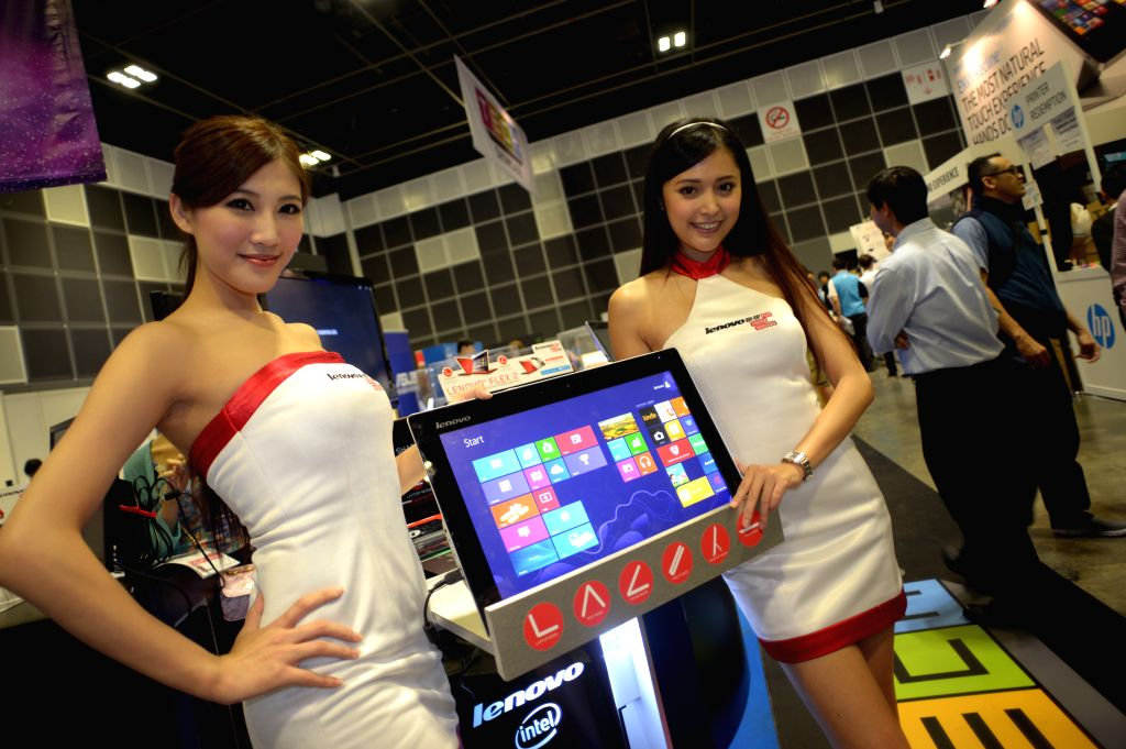 Models show a product during the COMEX Show in Singapore on Aug. 28, 2014. COMEX Show opened for the first day of exhibition in Singapore on Thursday. ...