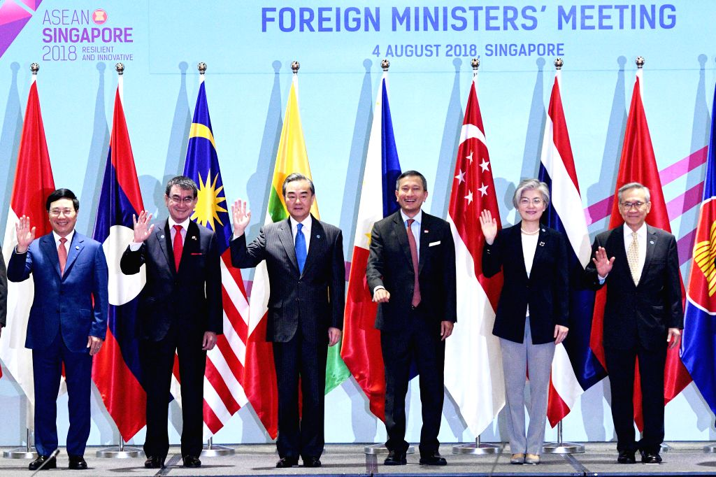 SINGAPORE, Aug. 4, 2018 - Chinese State Councilor and Foreign Minister Wang Yi (3rd L) poses for a group photo during the foreign ministers' meeting of the 10 member states of the Association of ... - Wang Y