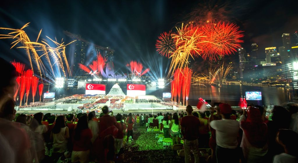SINGAPORE, Aug. 9, 2017 - Firework is pictured during the national day parade and celebration held in Singapore's Marina Bay on Aug. 9, 2017. Singapore celebrated its 52nd anniversary of independence ...