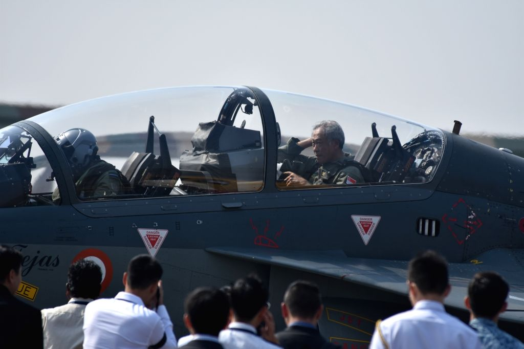 Singapore Defence Minister Dr. Ng Eng Hen in the cockpit of India's indigenous fighter aircraft Tejas at Kalaikunda in West Bengal on Nov 27, 2017. Hen, who is on a tour to India, will ... - D