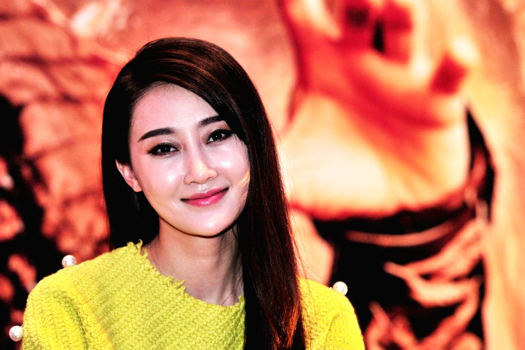 """Chinese actress Lin Peng attends the press conference of movie """"Dragon Blade"""" in Singapore, Feb. 10, 2015. Today, Cast members of the movie """"Dragon - Lin Peng"""