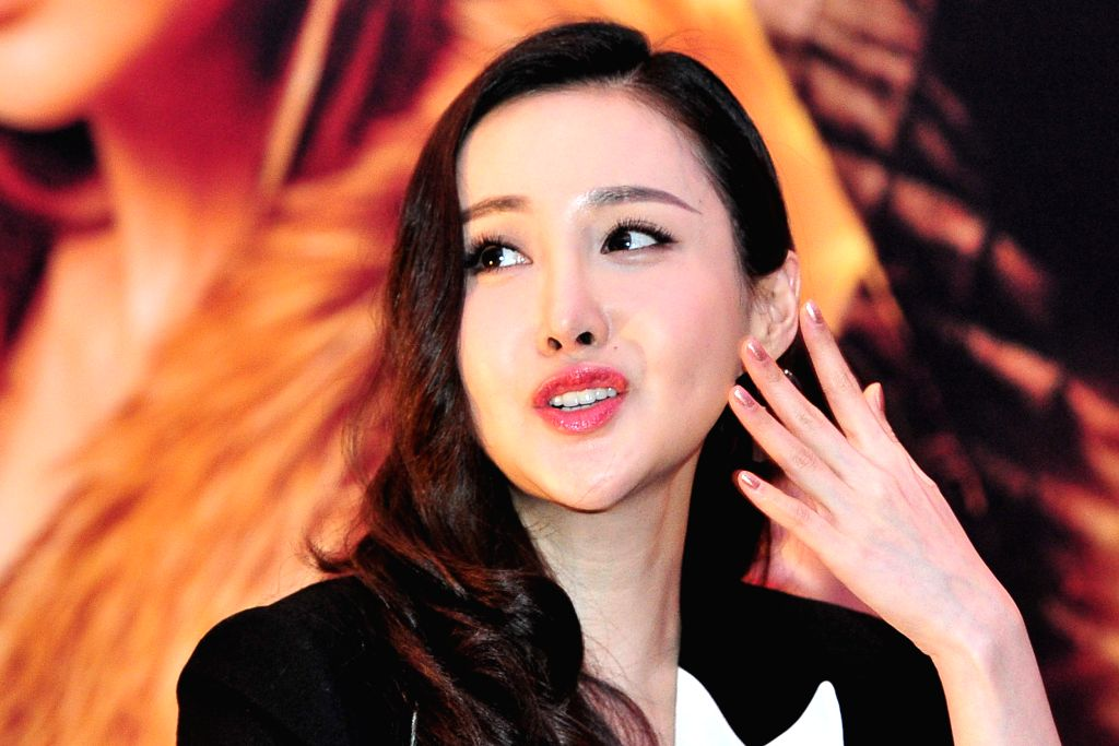 """Chinese actress Mika Wang attends the press conference of movie """"Dragon Blade"""" in Singapore, Feb. 10, 2015. Today, Cast members of the movie ... - Mika Wang"""