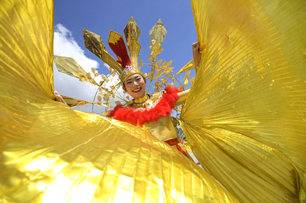 SINGAPORE, Feb. 14, 2019 - A performer from Vietnam troupe performs for the media preview of Chingay Parade at the F1 Pit Building in Singapore, Feb 14, 2019. The Chingay Parade will be held at ...