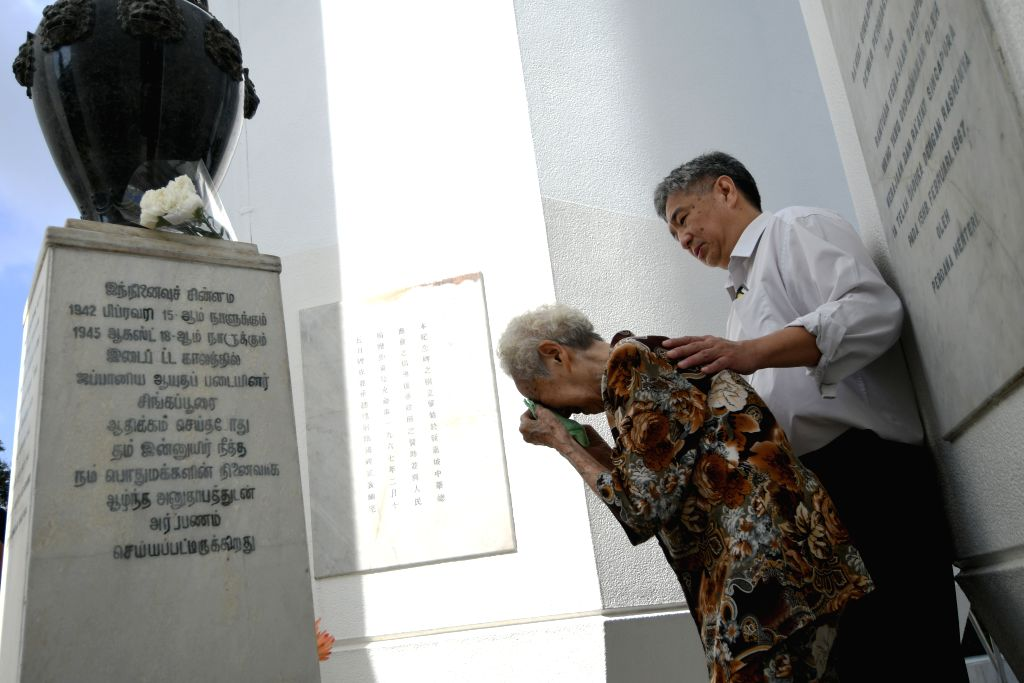SINGAPORE, Feb. 15, 2018 - An old woman wipes her tears during the war memorial service held at the War Memorial Park in Singapore on Feb. 15, 2018. Singapore Thursday held the 51st War Memorial ...