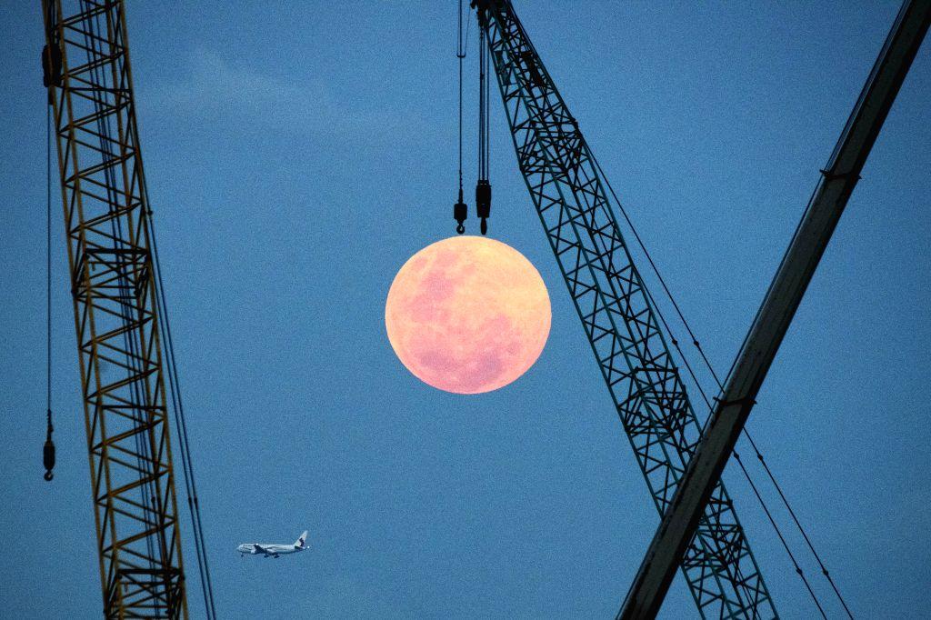 SINGAPORE, Feb. 19, 2019 - A full moon rises on the eastern coast of Singapore on Feb. 19, 2019.