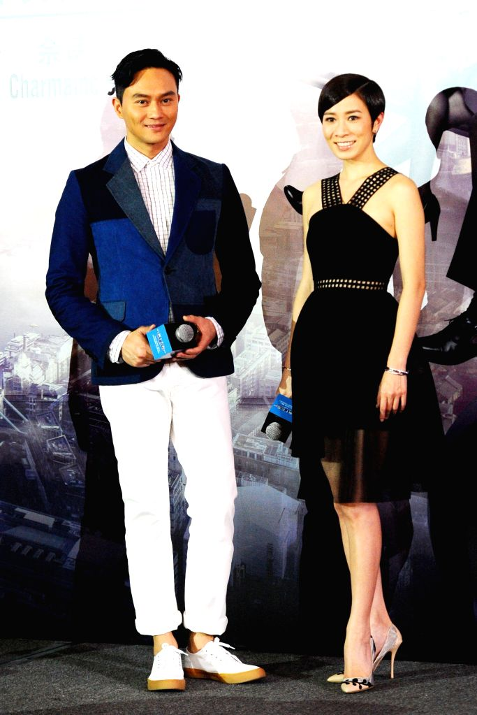 """Hong Kong Actor Julian Cheung (L) and Charmaine Sheh attend the gala premiere of movie """"Triumph in the Skies"""" in Singapore's Marina Bay Sands, Feb. 16, 2015. (Xinhua/Then Chih ... - Julian Cheung"""