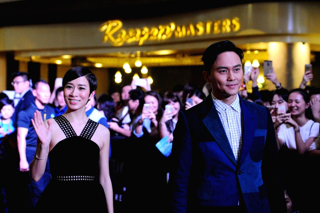 """Hong Kong Actor Julian Cheung (R, front) and Charmaine Sheh (L, front) walk the red carpet at the gala premiere of movie """"Triumph in the Skies"""" in Singapore's Marina Bay Sands, .. - Julian Cheung"""