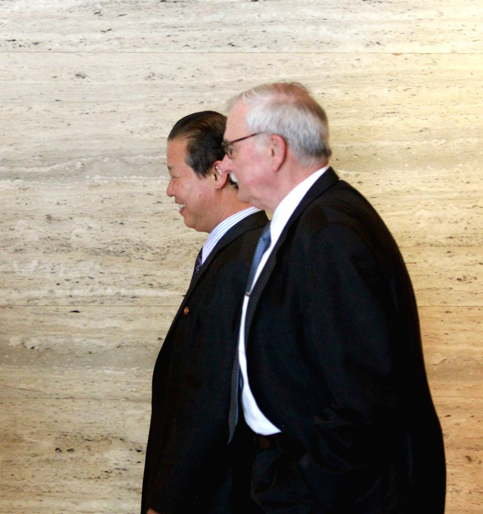 Representatives of the U.S. (Front) and the Democratic People's Republic of Korea (DPRK) leave for lunch after an informal meeting in Singapore Jan. 18, 2015. The