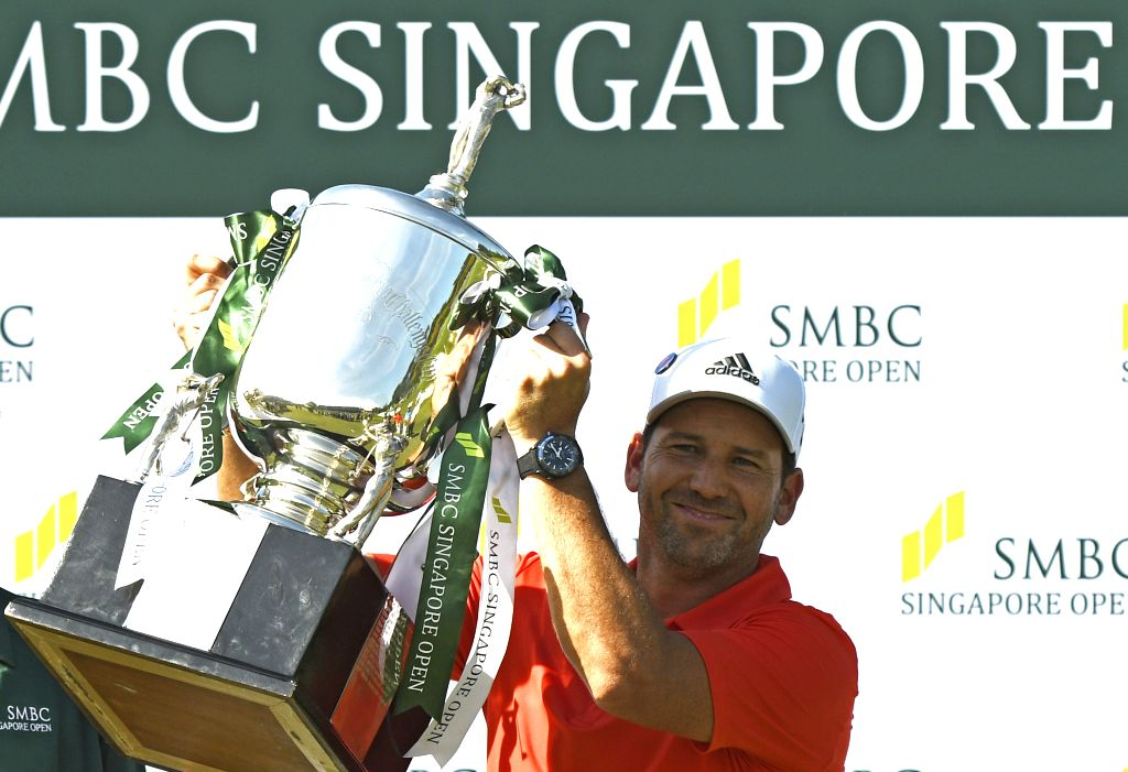 SINGAPORE, Jan. 21, 2018 - Spain's Sergio Garcia celebrates with his trophy after winning the final day competition of the SMBC Singapore Open held in Singapore's Sentosa Golf Club on Jan 21, 2018. ...