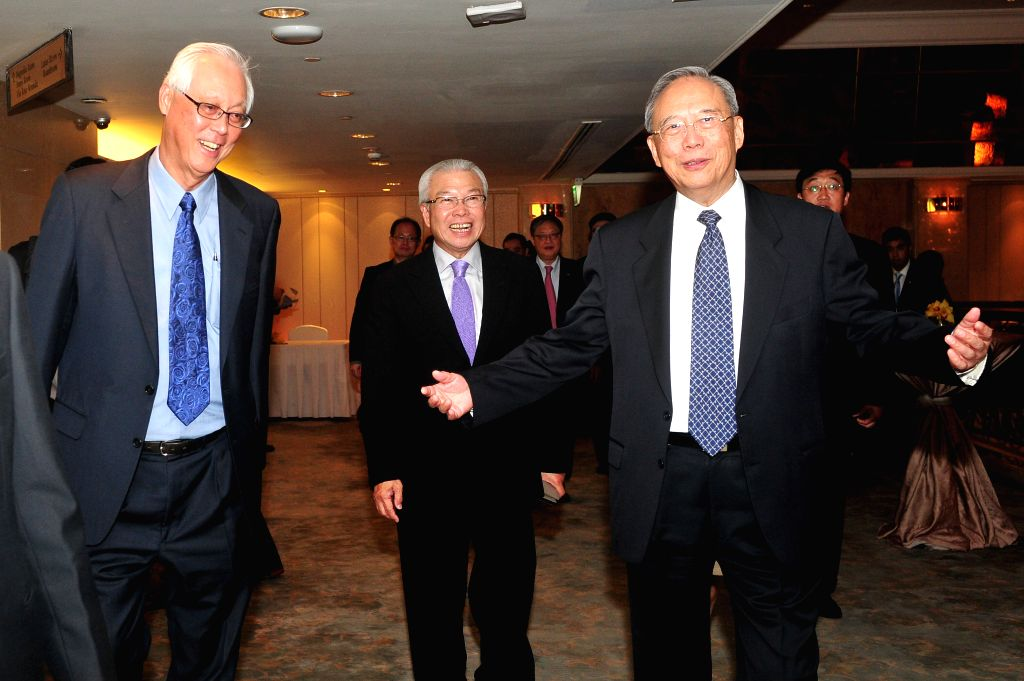 Singapore's Emeritus Senior Minister Goh Chok Tong, Business China's Chairman Chua Thian Poh and China's former Vice Premier and Boao Forum for Asia's Vice ... - Goh Chok Tong