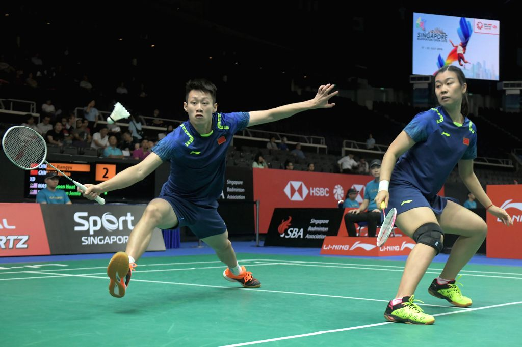 SINGAPORE, July 19, 2018 - China's Ren Xiangyu/Tang Jinhua compete during the mixed doubles second round match against Malaysia's Goh Soon Huat/Shevon Jemie Lai at 2018 Singapore Badminton Open held ...