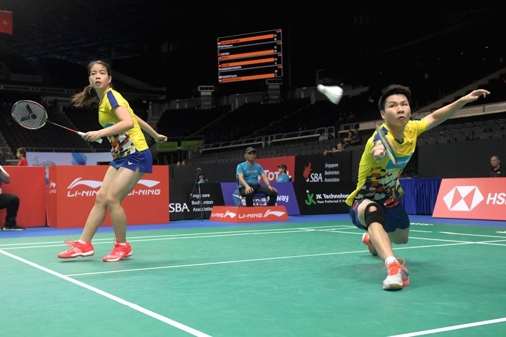 SINGAPORE, July 19, 2018 - Goh Soon Huat (R)/Shevon Jemie Lai of Malaysia compete during the mixed doubles second round match against Ren Xiangyu/Yang Jinhua of China at 2018 Singapore Badminton Open ...