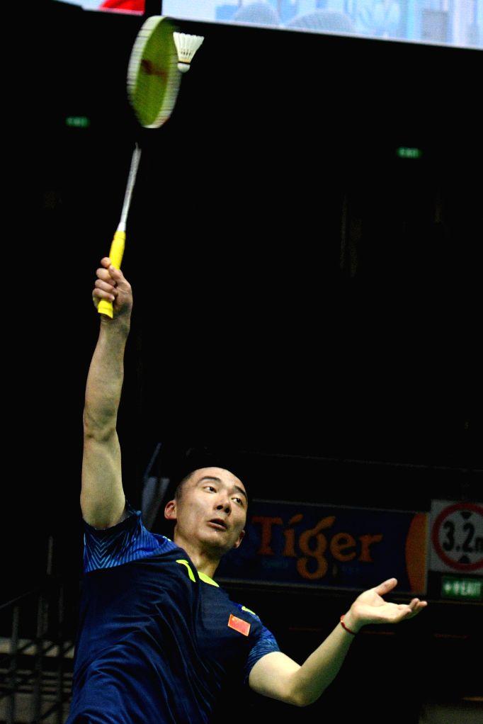 SINGAPORE, July 19, 2018 - Huang Yuxiang of China hits a return during the men's singles second round match against Ng Ka Long Angus of China's Hong Kong at 2018 Singapore Badminton Open held at ...