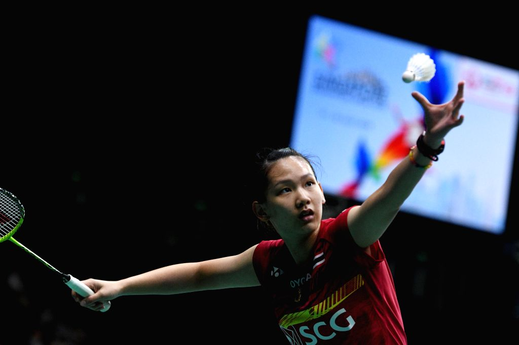 SINGAPORE, July 19, 2018 - Pornpawee Chochuwong of Thailand serves during the women's singles second round  match against Han Yue of China at 2018 Singapore Badminton Open held at Singapore Indoor ...
