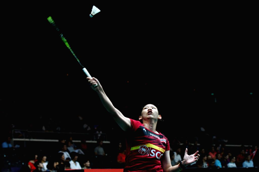 SINGAPORE, July 19, 2018 - Pornpawee Chochuwong of Thailand hits a return during the women's singles second round  match against Han Yue of China at 2018 Singapore Badminton Open held at Singapore ...