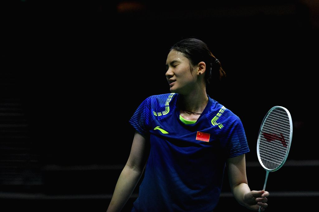 SINGAPORE, July 21, 2018 - Han Yue of China reacts during the women's singles semi-final match against Sayaka Takahashi of Japan at 2018 Singapore Badminton Open held at Singapore Indoor Stadium in ...