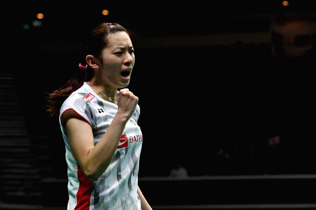 SINGAPORE, July 21, 2018 - Sayaka Takahashi of Japan celebrates during the women's singles semi-final match against Han Yue of China at 2018 Singapore Badminton Open held at Singapore Indoor Stadium ...