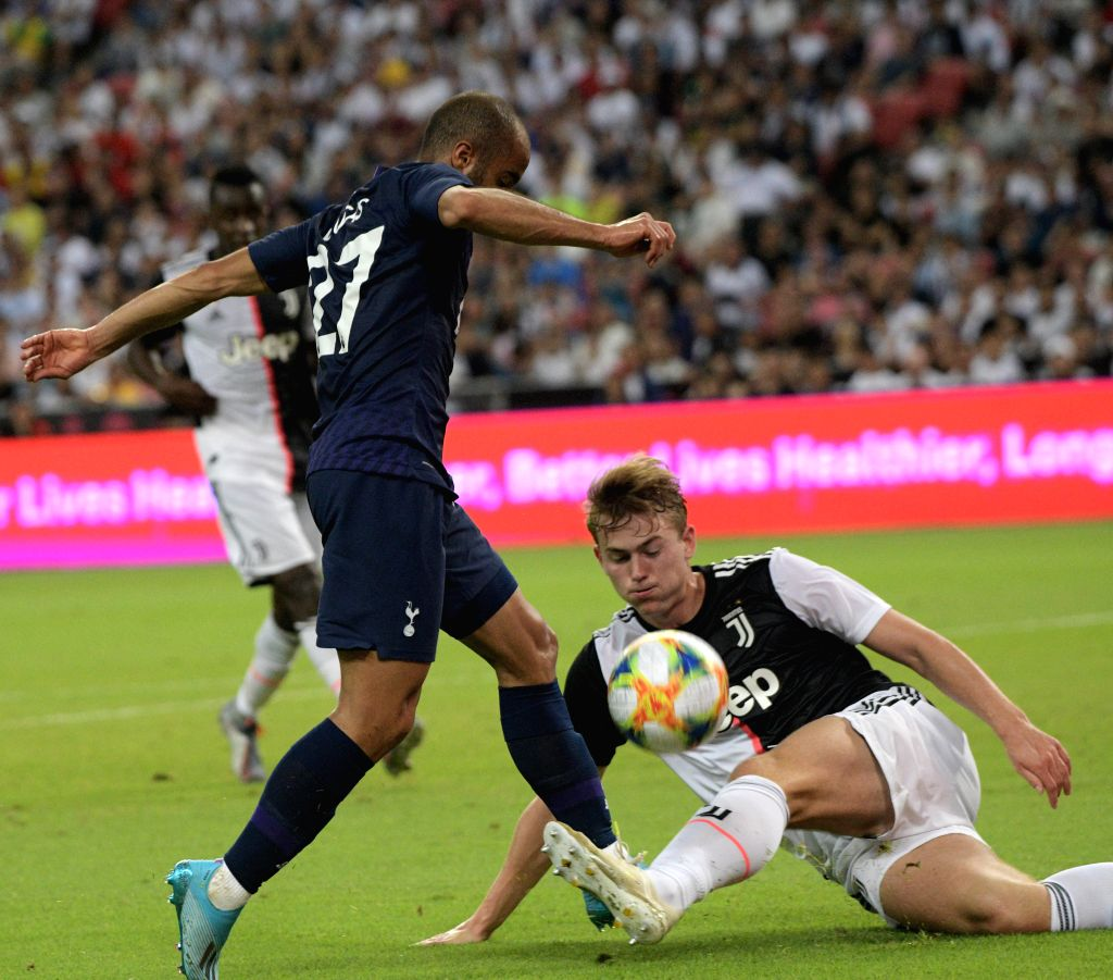 SINGAPORE, July 21, 2019 - Lucas (L) of Tottenham Hotspur vies with Matthijs De Ligt of Juventus during the International Champions Cup football match between Tottenham Hotspur and Juventus in ...