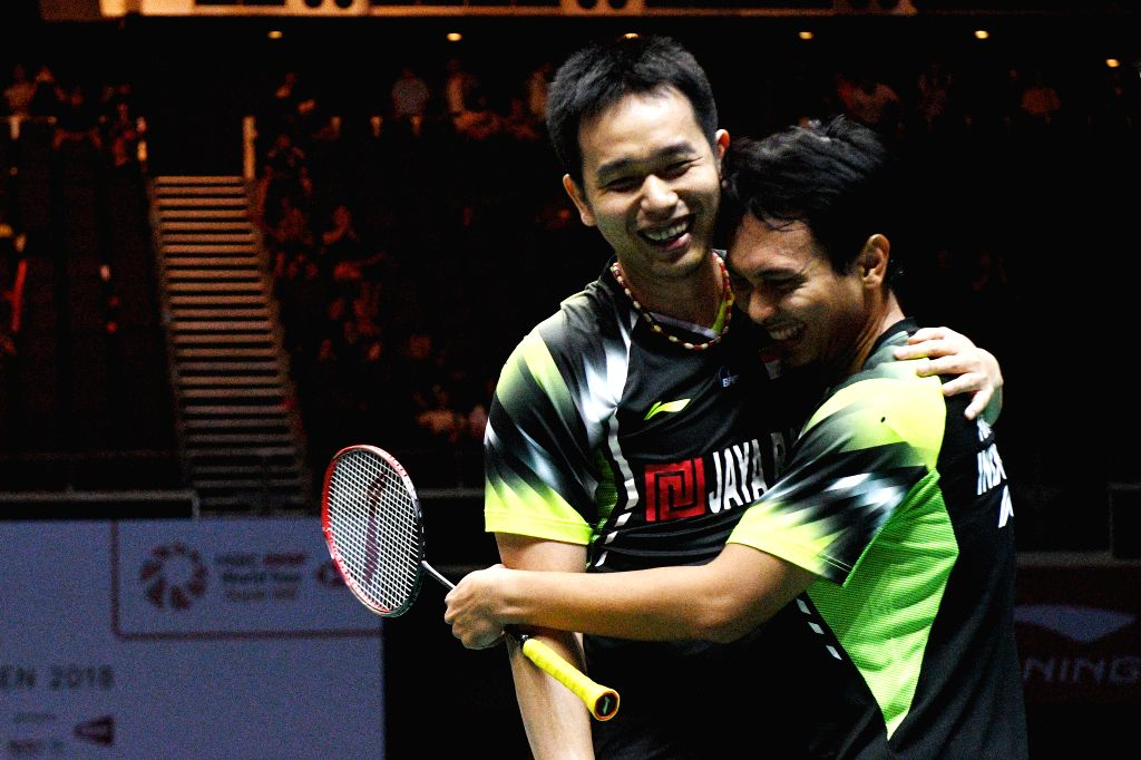 SINGAPORE, July 22, 2018 - Indonesia's Mohammad Ahsan/Hendra Setiawan (L) celebrate after winning the men's doubles final against Ou Xuanyi/Ren Xiangyu of China at the Singapore Badminton Open held ...