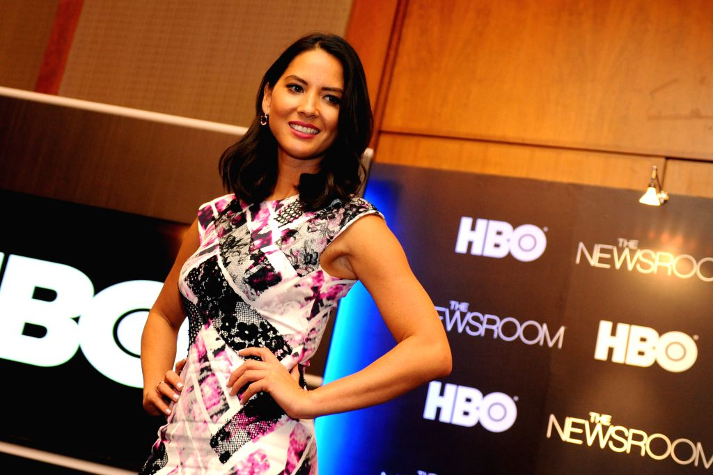 """SINGAPORE, July 23, 2013 (Xinhua/IANS) -- Actress Olivia Munn attends the press conference to promote the second season of the television show """"The Newsroom"""" at the Four Seasons Hotel in Singapore, July 23, 2013. (Xinhua/Then Chih Wey) - Olivia Munn"""