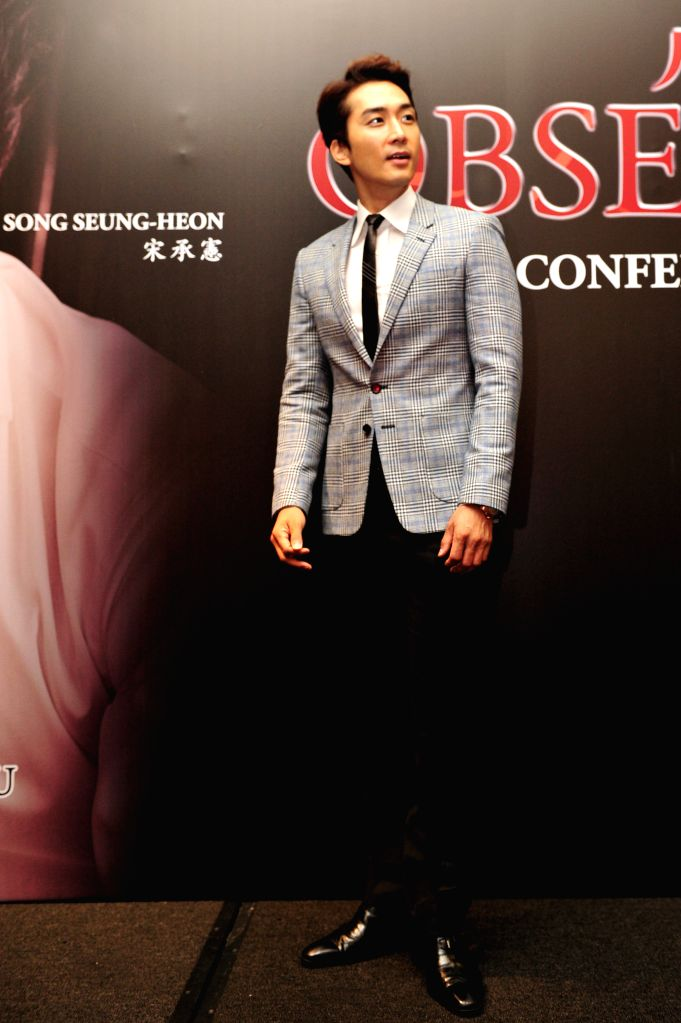 """South Korean actor Song Seung-heon attends the press conference of the film """"Obsessed"""" in Singapore, July 25, 2014. - Song Seung"""
