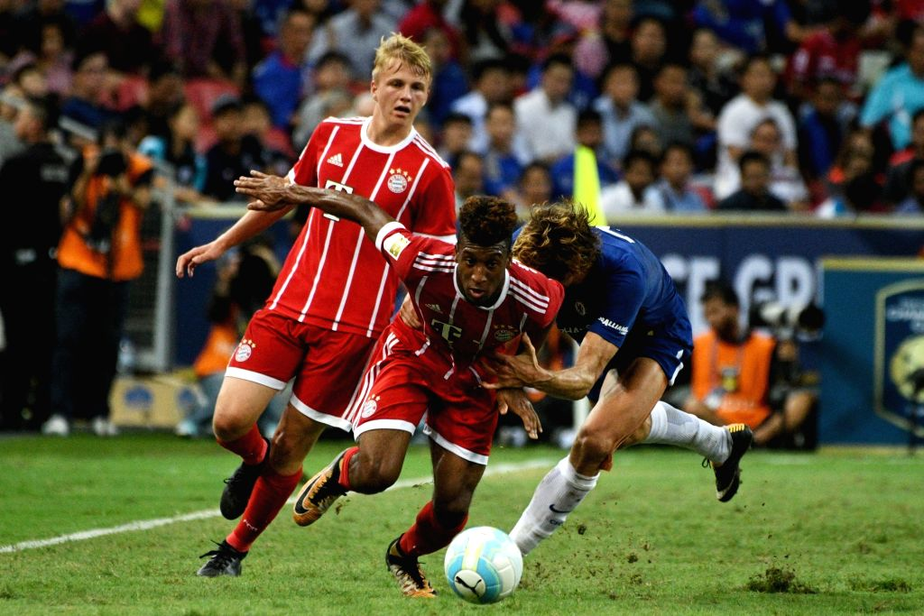SINGAPORE, July 25, 2017 - Bayern Munich's Kingsley Coman (Front) competes during the International Champions Cup soccer match between Chelsea and Bayern Munich in Singapore's National Stadium, on ...