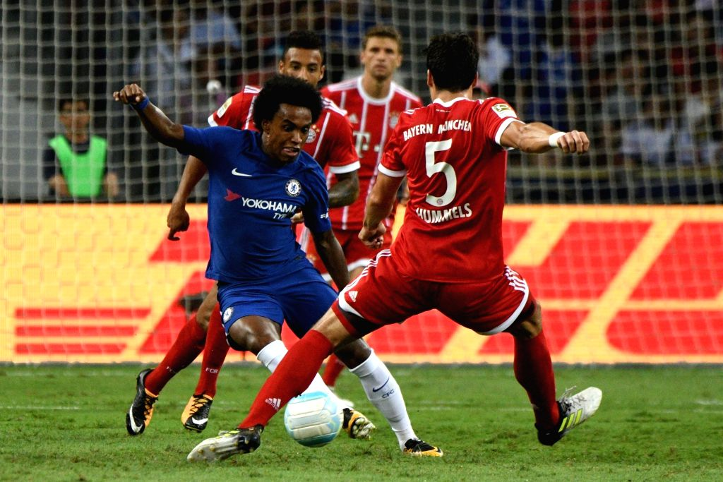 SINGAPORE, July 25, 2017 - Willian (L) of Chelsea vies with Mats Hummels of Bayern Munich during the International Champions Cup soccer match between Chelsea and Bayern Munich in Singapore's National ...