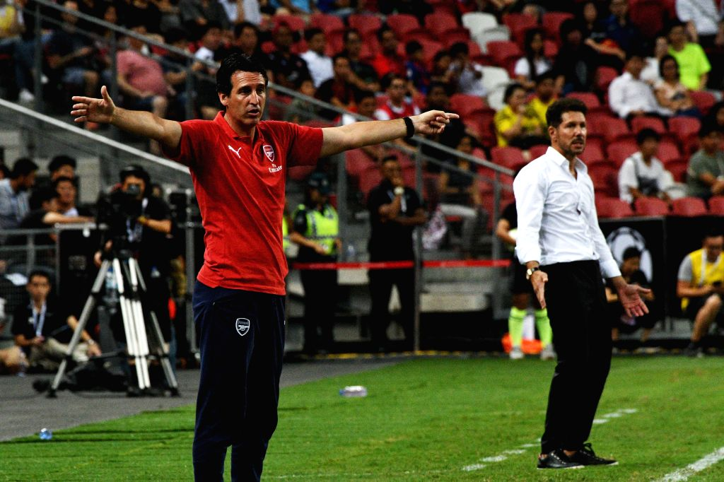SINGAPORE, July 26, 2018 - Head coach Unai Emery (L) of Arsenal and Head coach Diego Simeone of Atletico de Madrid gesture during the International Champions Cup match between Atletico de Madrid and ...
