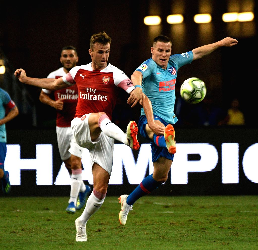 SINGAPORE, July 26, 2018 - Kevin Gameiro (1st R) of Atletico de Madrid vies with Rob Holding (1st L) of Arsenal during the International Champions Cup match between Atletico de Madrid and Arsenal in ...