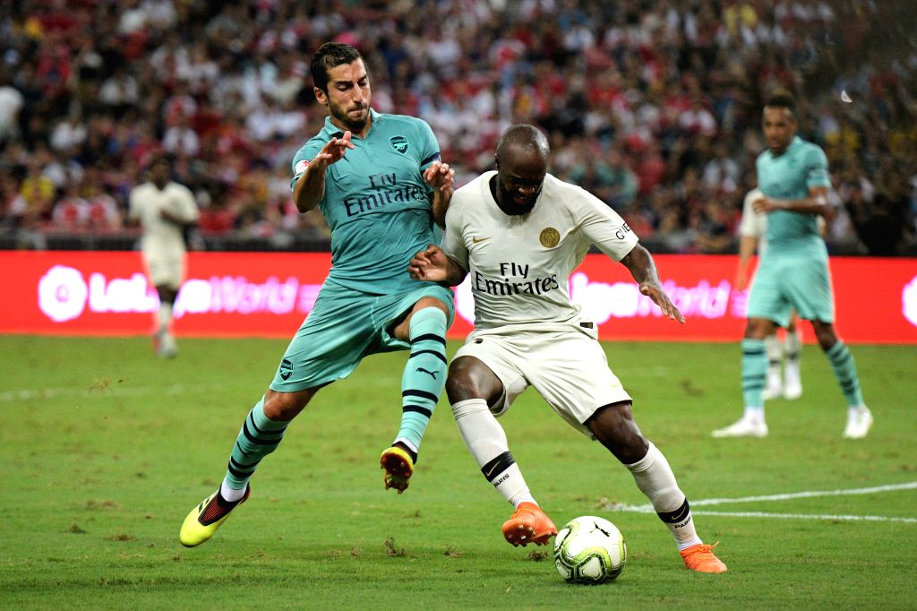 SINGAPORE, July 28, 2018 - Arsenal's Henrikh Mkhitaryan (L) vies with Paris Saint-Germain's Lassana Diarra during the International Champions Cup soccer match held in Singapore on July 28, 2018.