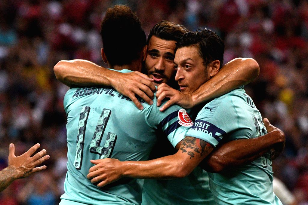 SINGAPORE, July 28, 2018 - Arsenal's Mesut Ozil (R) celebrates with teammates after scoring during the International Champions Cup soccer match between Arsenal and Paris Saint-Germain held in ...
