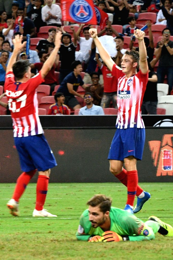 SINGAPORE, July 30, 2018 - Atletico de Madrid's Borja Garces (R) celebrates scoring a goal during the International Champions Cup match between Paris Saint-Germain and Atletico de Madrid held in ...