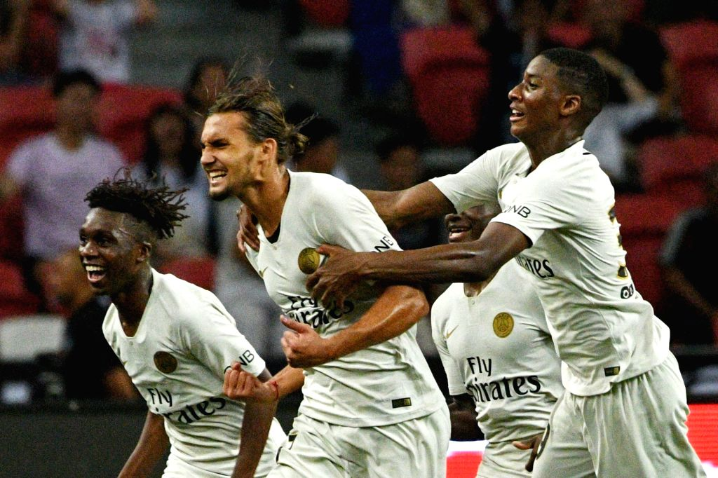 SINGAPORE, July 30, 2018 - Paris Saint-Germain's Virgiliu Postolachi (2nd L) celebrates with his teammates after scoring the winning goal during the International Champions Cup match between Paris ...