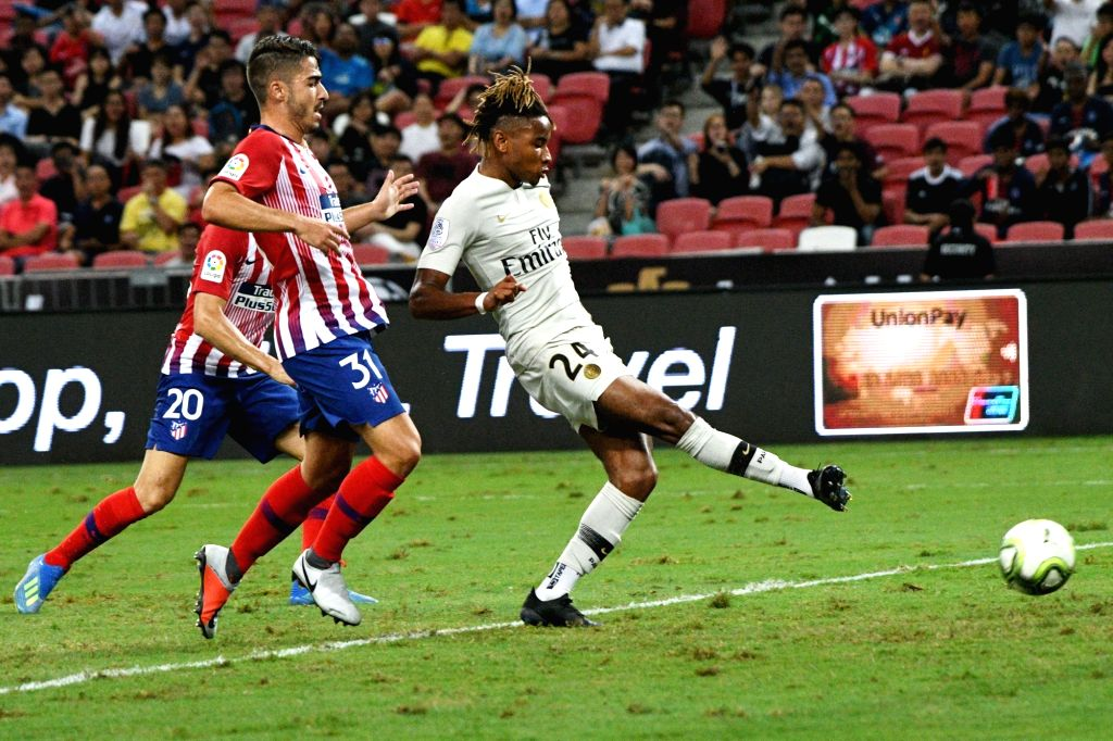 SINGAPORE, July 30, 2018 - Paris Saint-Germain's Christopher Nkunku (R) shoots and scores during the International Champions Cup match between Paris Saint-Germain and Atletico de Madrid held in ...