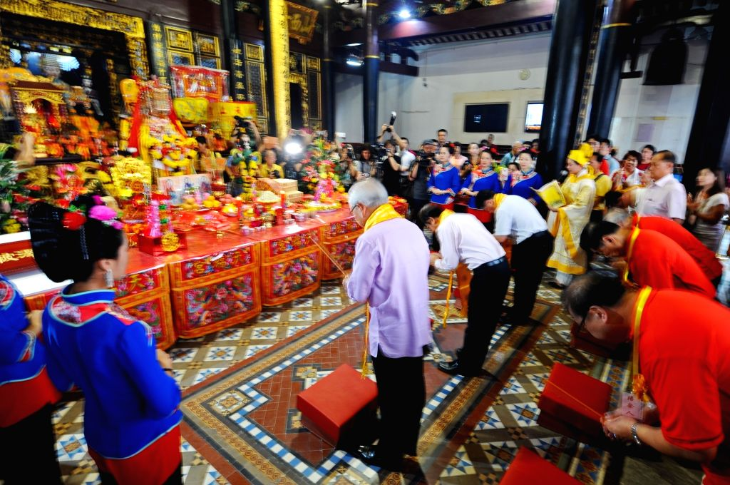 SINGAPORE, July 6, 2017 - People attend the prayer ceremony for the deity Mazu from Meizhou place at Singapore's Thian Hock Keng temple on July 6, 2017.