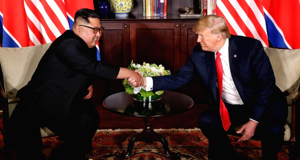 SINGAPORE, June 12, 2018 (Xinhua) -- Top leader of the Democratic People's Republic of Korea (DPRK) Kim Jong Un (L) meets with U.S. President Donald Trump in Singapore, on June 12, 2018. (Xinhua/Ministry of Communication and Information of Singapore/