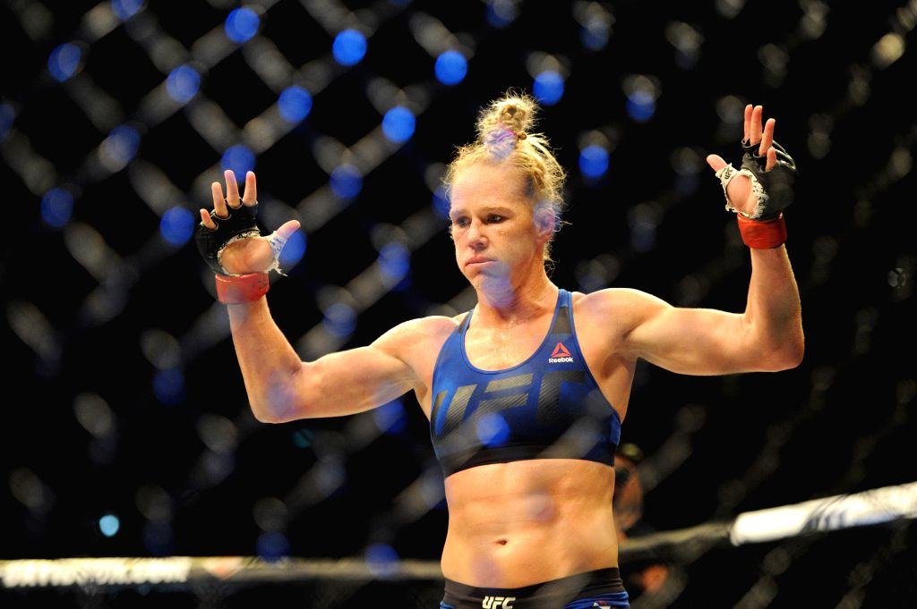 SINGAPORE, June 17, 2017 - Holly Holm of the United States celebrates after the women's bantamweight bout against Bethe Correia of Brazil at the UFC Fight Night held in Singapore Indoor Stadium on ...