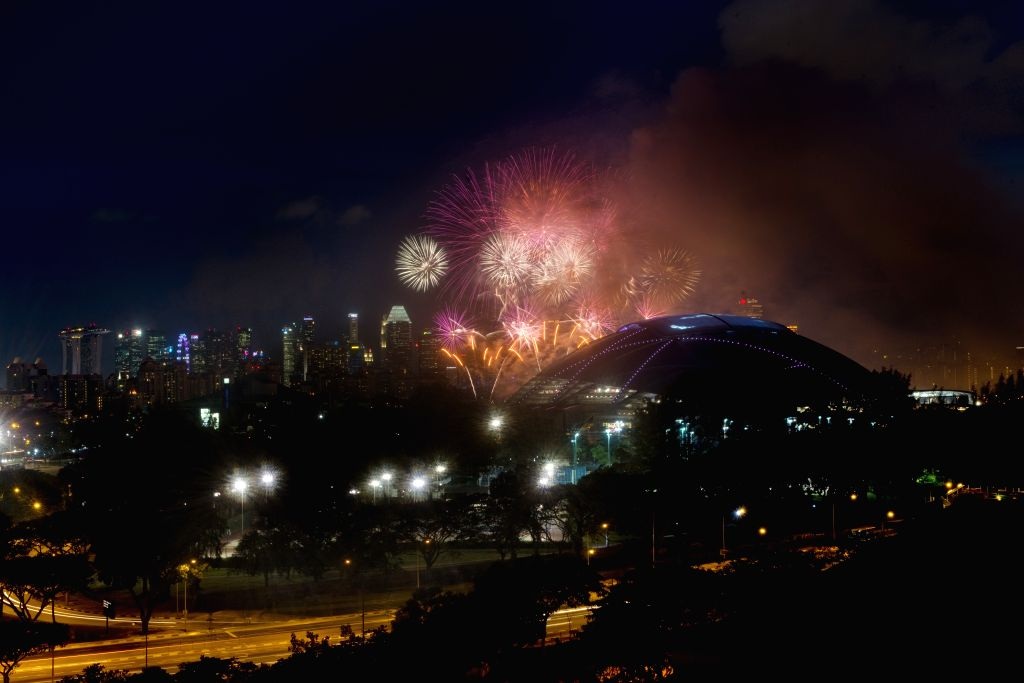 Colourful fireworks light up the sky above the Singapore Sports Hub on June 27, 2014. Singapore celebrates the 1-year countdown to the 2015 South East Asian Games