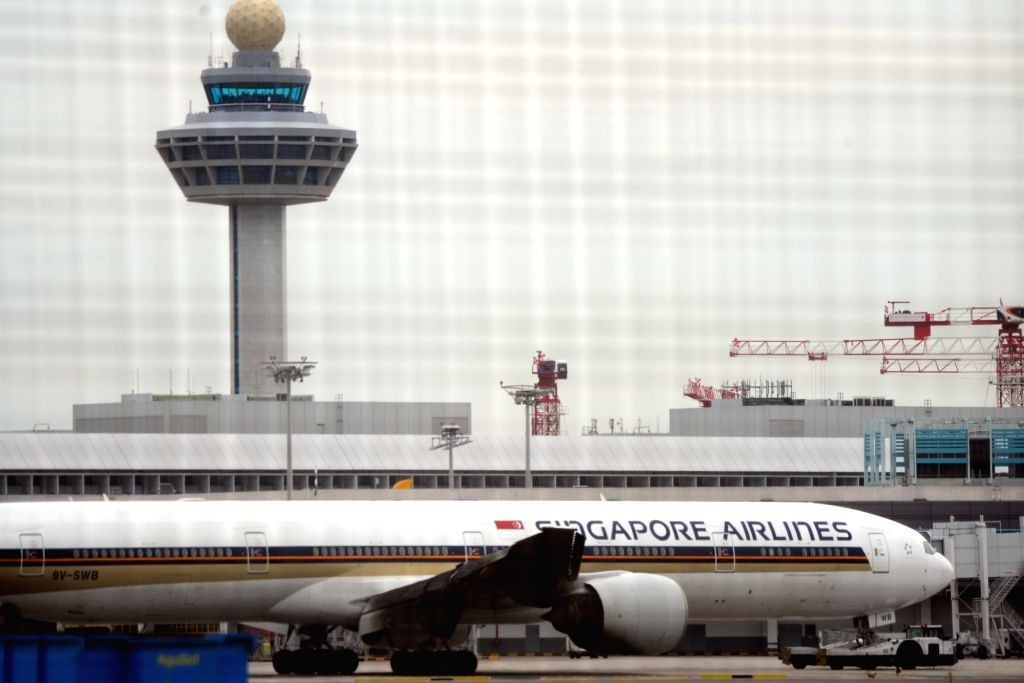 SINGAPORE, June 27, 2016 - A Singapore Airlines passenger aircraft SQ368 with its burnt right wing is towed along the tarmac at Singapore Changi Airport, June 27, 2016. Today, the right wing of SQ368 ...